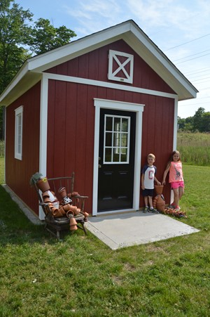 Independence Local Schools and community build children's garden shed for after school and summer camp programs
